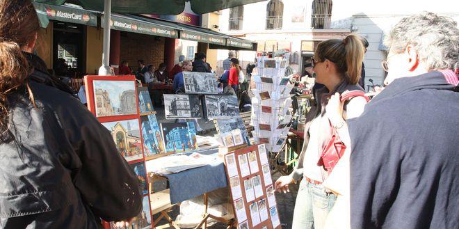 Уличные художники на рынке Меркадо-дель-Пуэрто