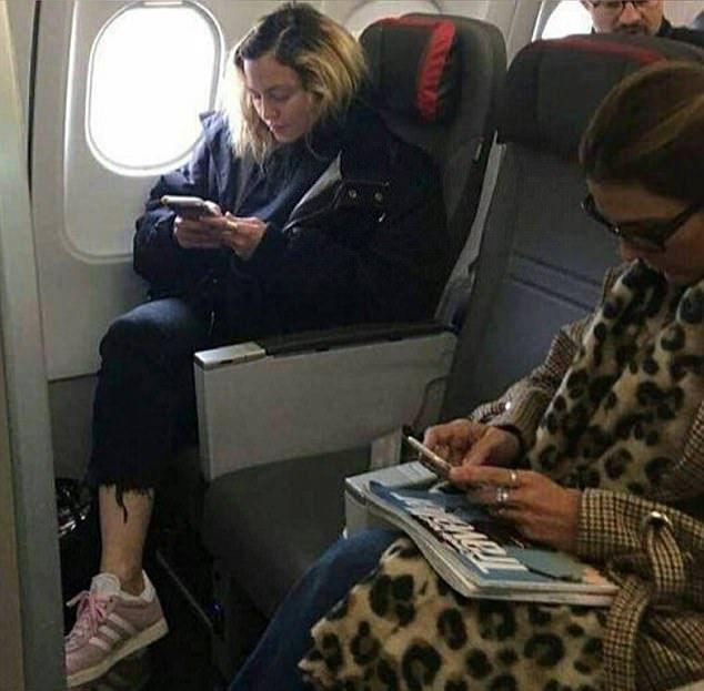 Мадонна летит эконом-классом