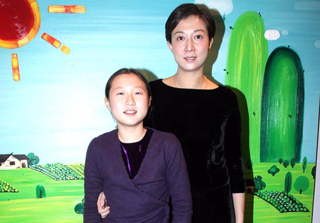 Элейнг Нг с дочерью