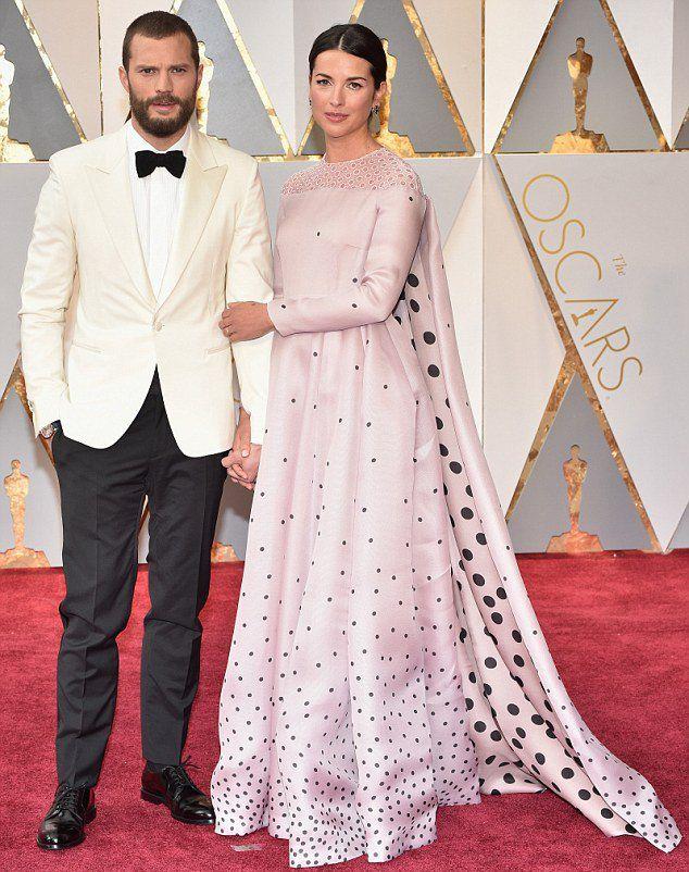 Джейми Дорнан и Амелия Уорнер на церемонии вручения премии «Оскар» в этом году